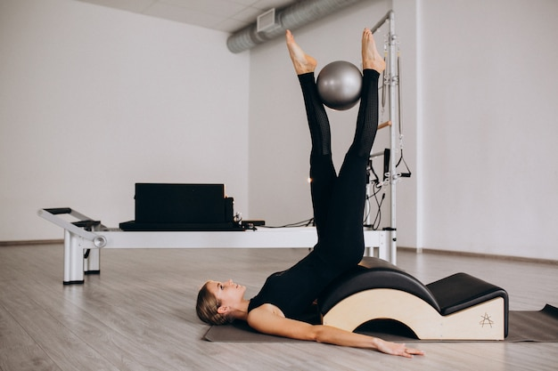 Woman doing pilates with a ball Free Photo