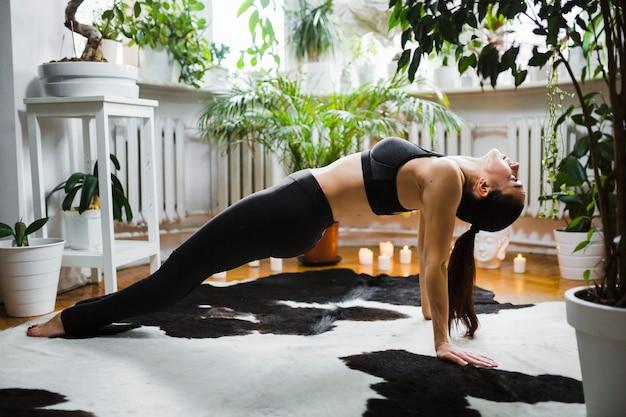 Woman doing upward plank Free Photo