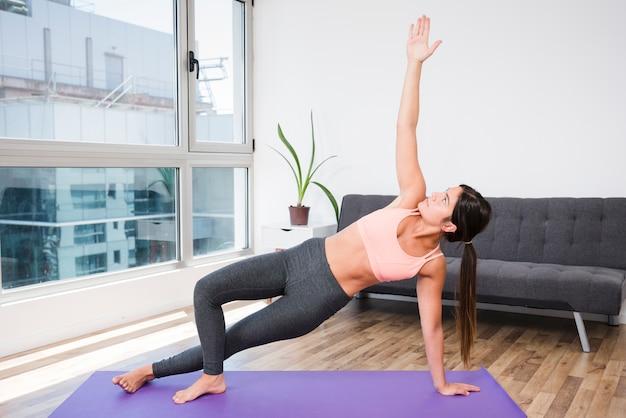 Woman doing yoga at home   Free Photo