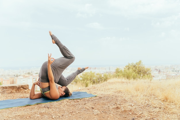 Woman doing yoga with legs up Free Photo
