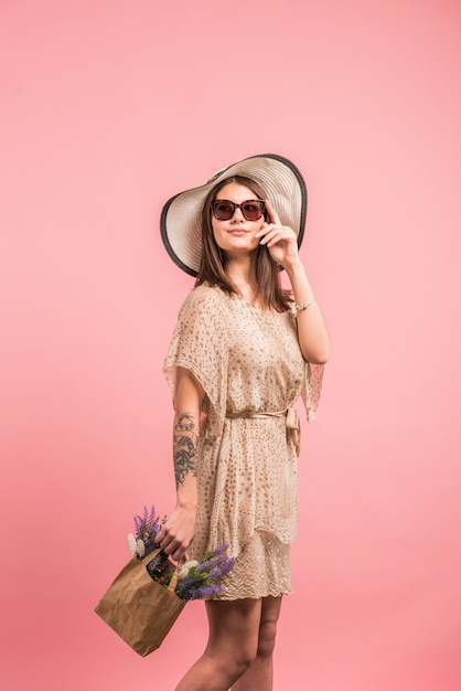 Woman in dress with flowers in bag Free Photo