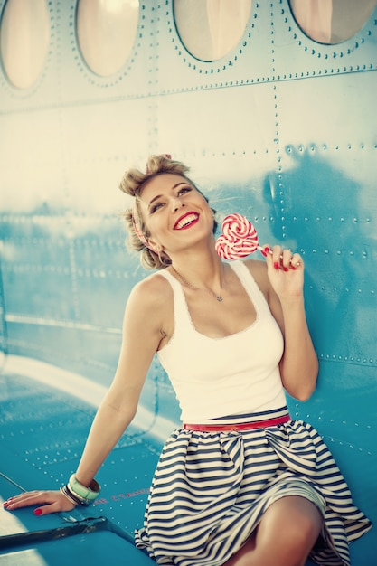 Woman dressed in old fashioned form with a flower in one hand Premium Photo