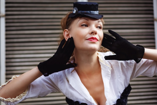 Woman dressed up in retro style posing Premium Photo