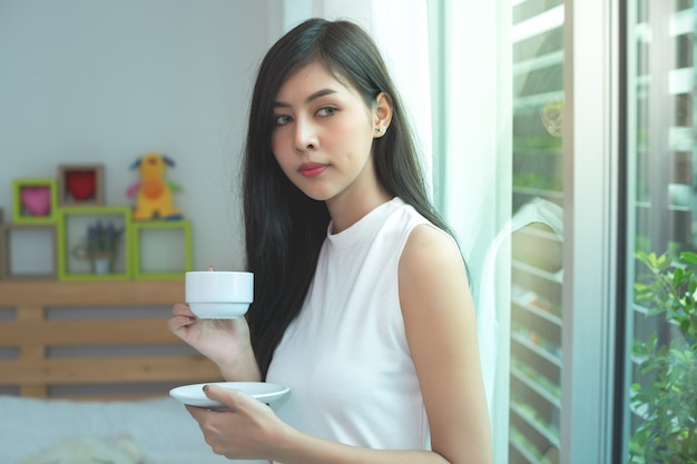 Woman drink a coffee on the morning Free Photo