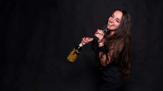 Woman drinking champagne from glass Free Photo