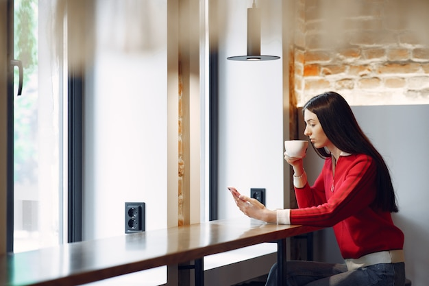 Woman drinking coffee in the morning at restaurant Free Photo