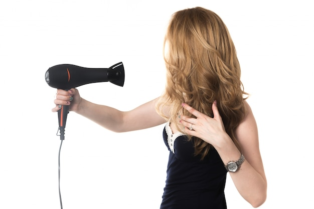 Woman drying her hair Free Photo