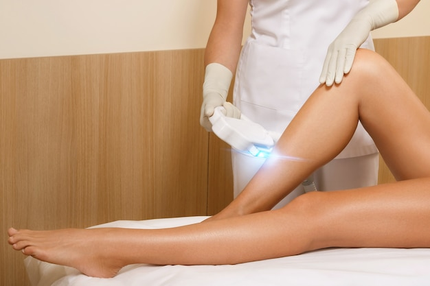 Woman during laser hair removal Premium Photo