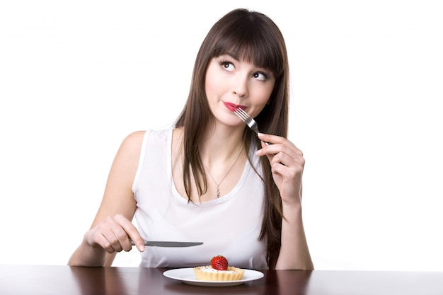 Woman eating a cake Free Photo