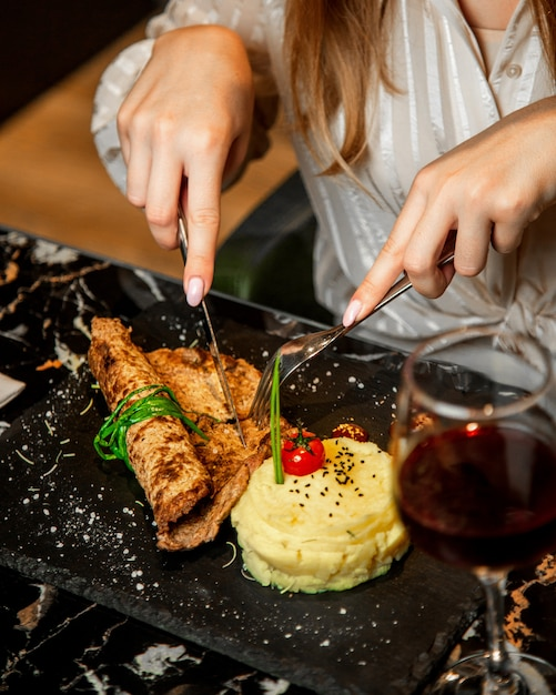 Woman eats a food with wine Free Photo