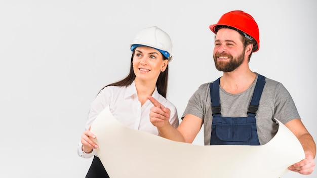 Woman engineer and builder discussing project pointing finger away Free Photo