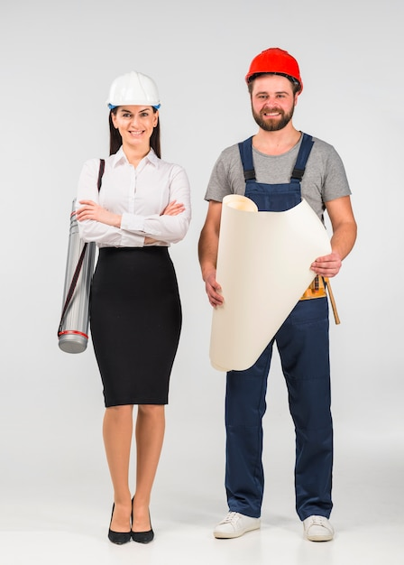 Woman engineer and builder standing with whatman paper Free Photo