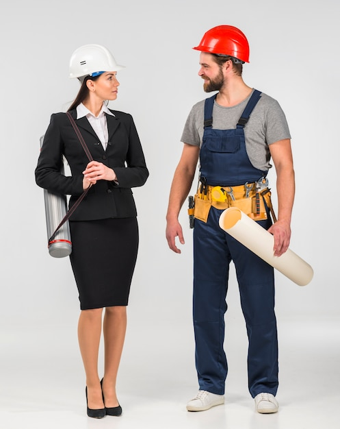 Woman engineer and builder talking Free Photo