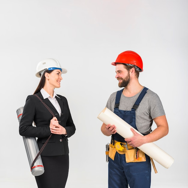 Woman engineer and builder with whatman smiling Free Photo