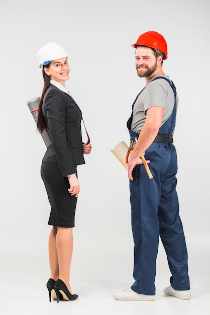 Woman engineer standing with builder smiling Free Photo