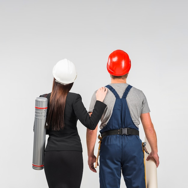 Woman engineer standing with builder Free Photo