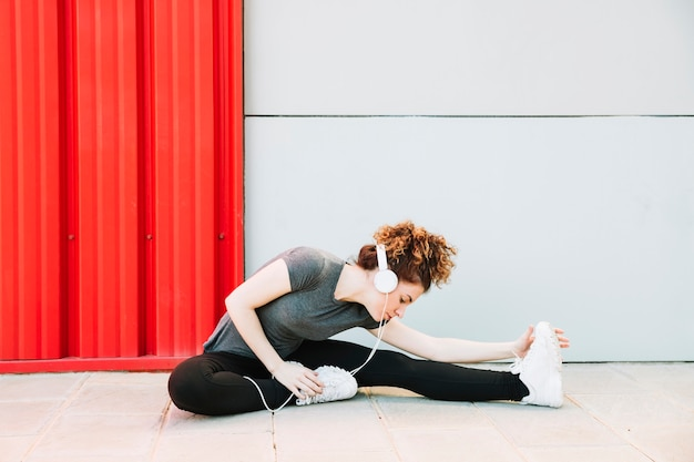 Woman enjoying music and stretching Free Photo
