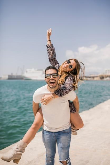 Woman enjoying piggyback ride on his boyfriend's back Free Photo