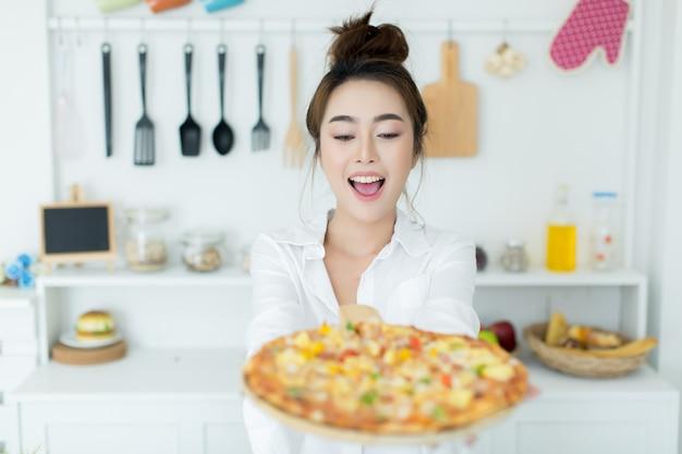 Woman enjoying pizza Free Photo