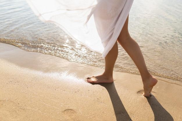Woman enjoying the sands on the beach Premium Photo