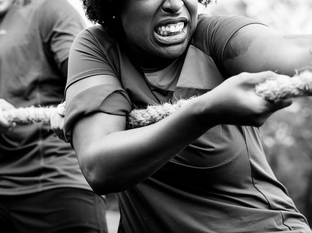 Woman enjoying tug of war Free Photo
