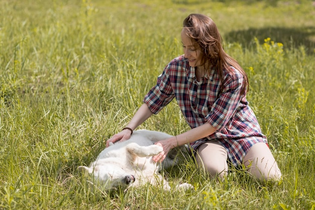 Woman enjoying with a dog in the countryside Free Photo
