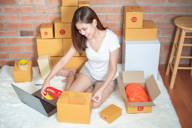 Woman entrepreneur owner sme business is checking order Premium Photo