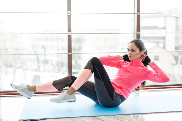 Woman exercising abs in gym Free Photo
