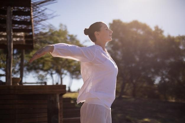 Woman exercising during safari vacation Free Photo