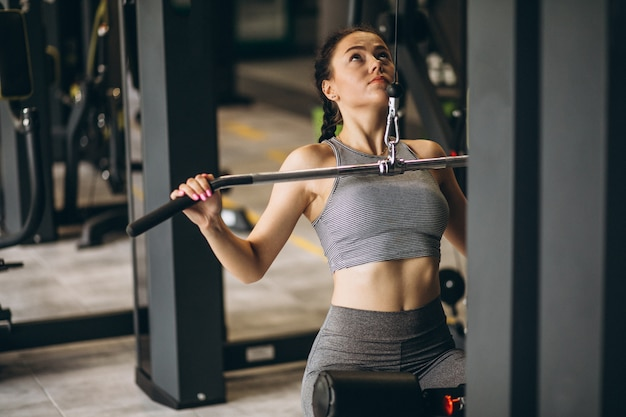 Woman exercising at the gym by herself Free Photo