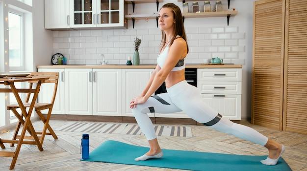 Woman exercising at home Free Photo
