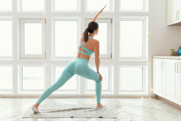 Woman exercising on mat Free Photo
