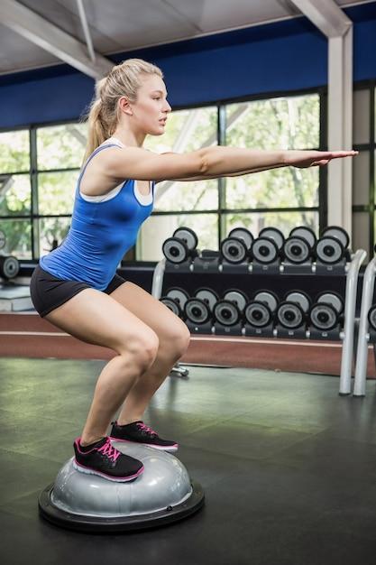 Woman exercising with bosu ball Premium Photo