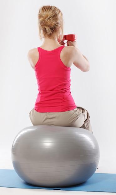 Woman exercising Free Photo