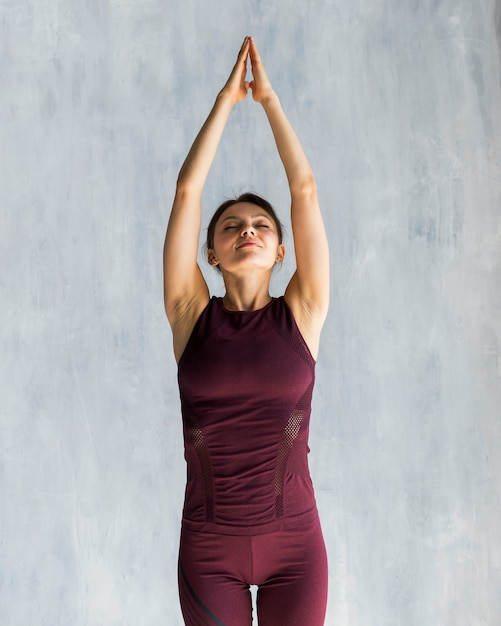 Woman extending during her yoga training Free Photo