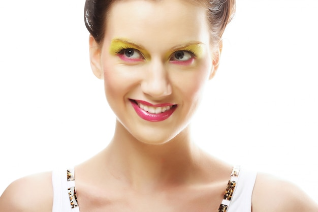 Woman face with bright makeup Premium Photo