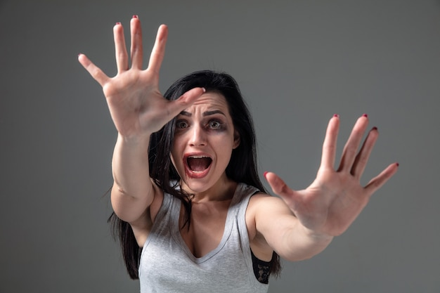Woman in fear of domestic abuse and violence, concept of female rights Free Photo