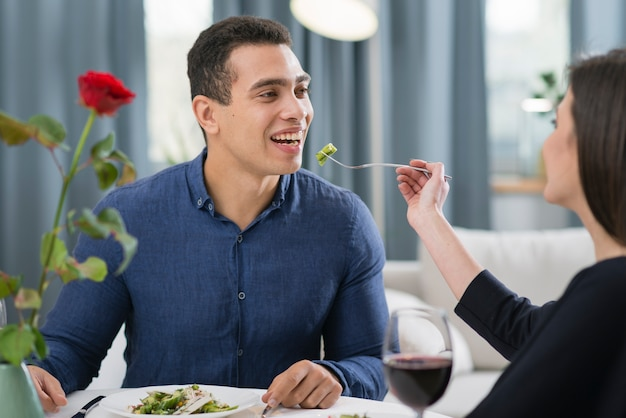 Woman feeding her husband at a romantic dinner Free Photo