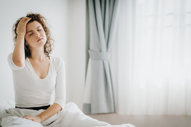 Woman feeling headache after wake up in the morning Premium Photo