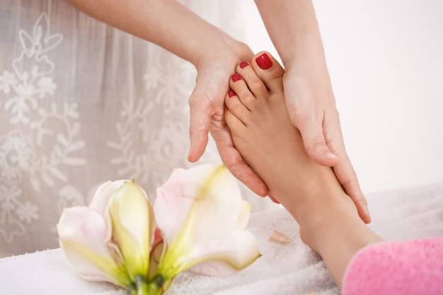 Woman feet at beauty saloon decorations getting nice relaxing massage Free Photo