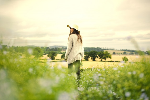 Woman in a field of flowers Premium Photo