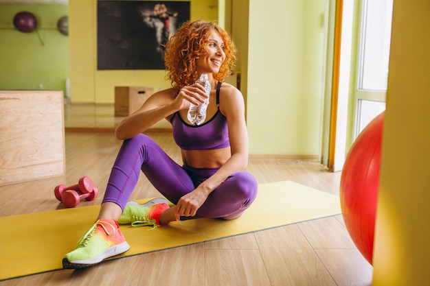 Woman fitness trainer lying on mat Free Photo