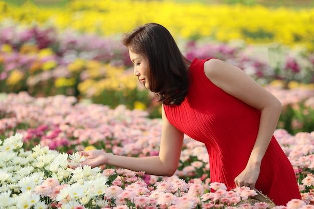 Woman in flower garden. Premium Photo