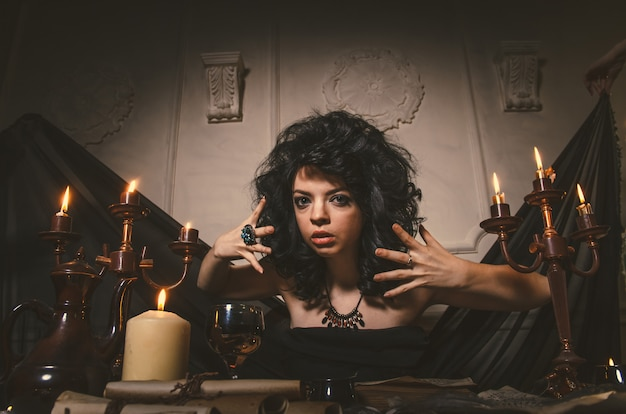 Woman fortune-teller guesses fate of night table Premium Photo