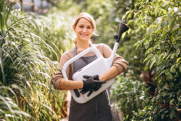 Woman gardner in a greenhouse Free Photo