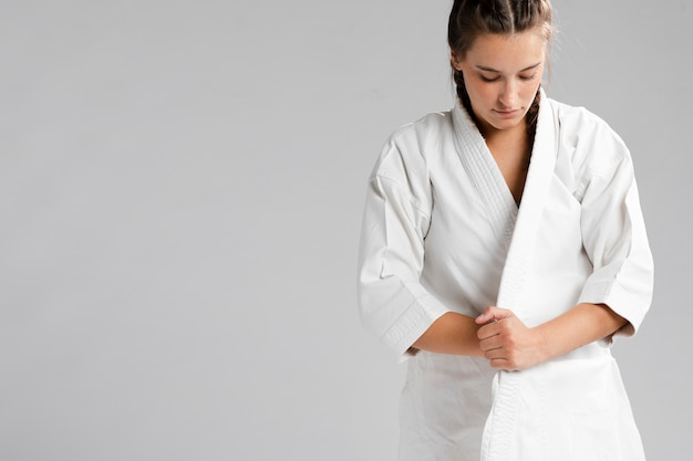 Woman getting dressed in uniform and copy space Free Photo