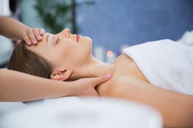 Woman getting a head massage Free Photo