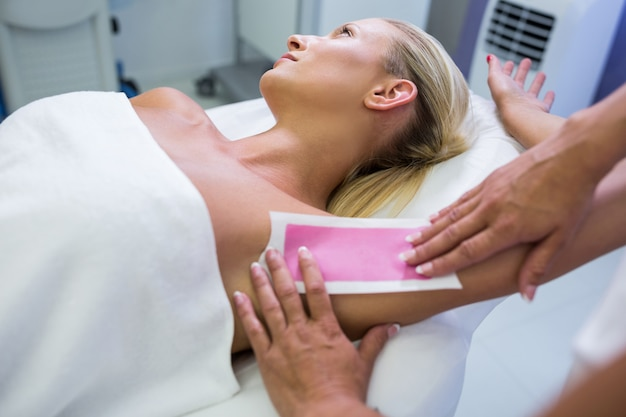 Woman getting her armpit hair removed Free Photo