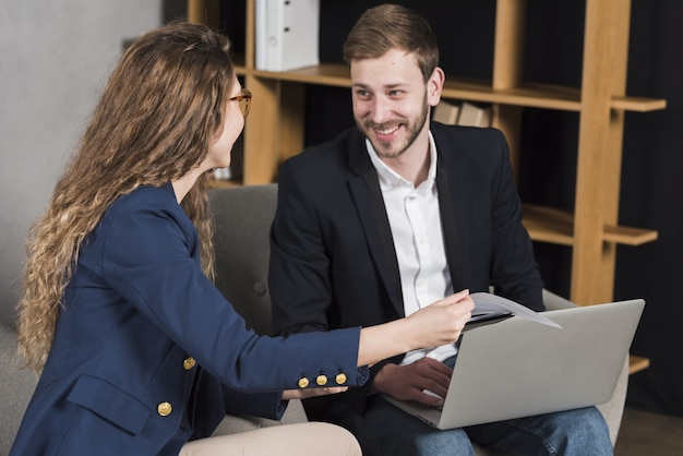 Woman getting interviewed by man for a job position Free Photo