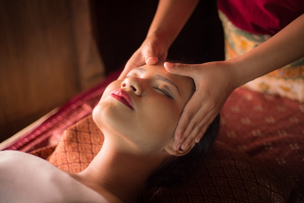 Woman getting a massage on her face Free Photo
